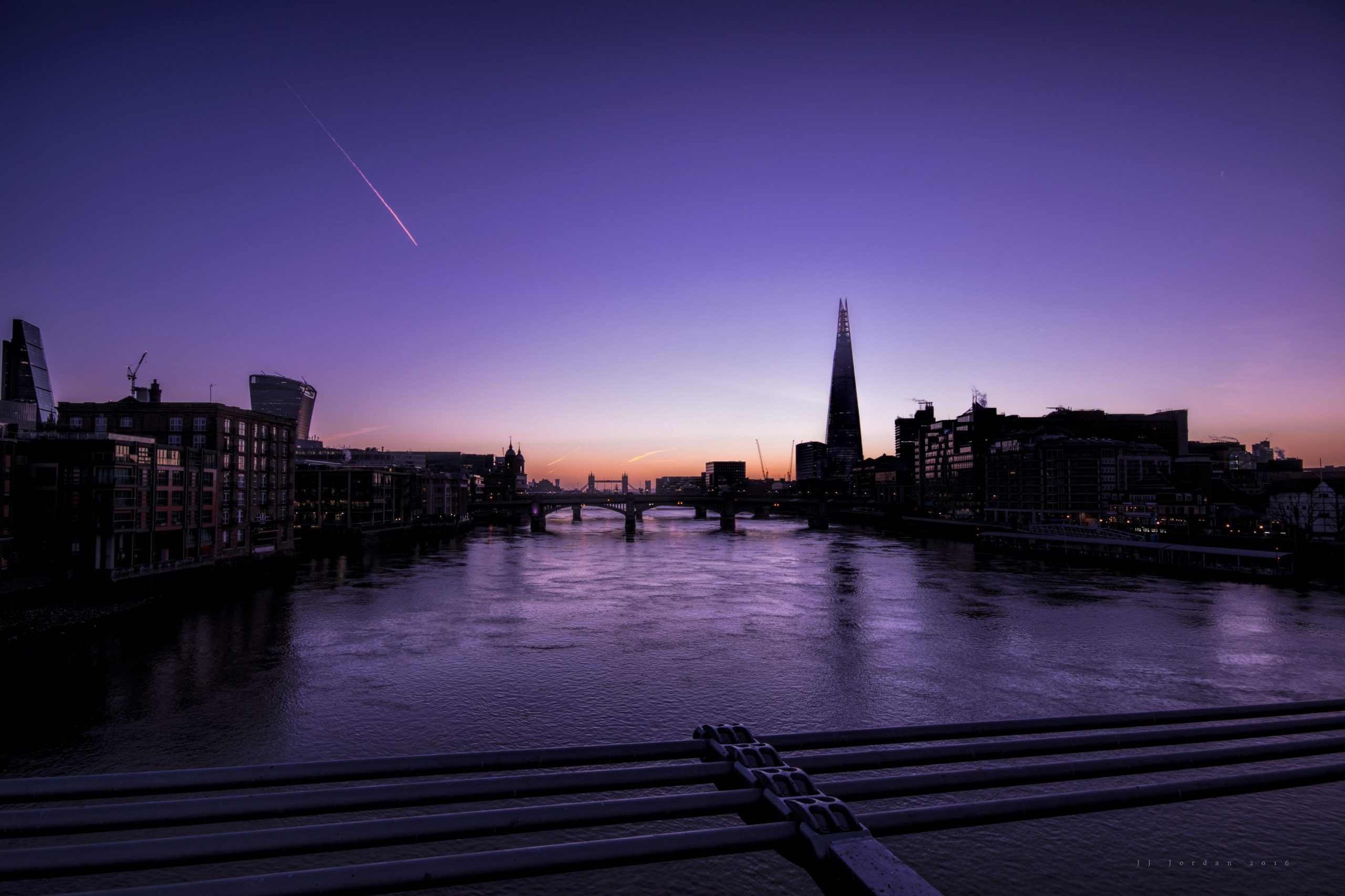 View from Millennium Bridge with Tower Bridge and The Shard in the distance